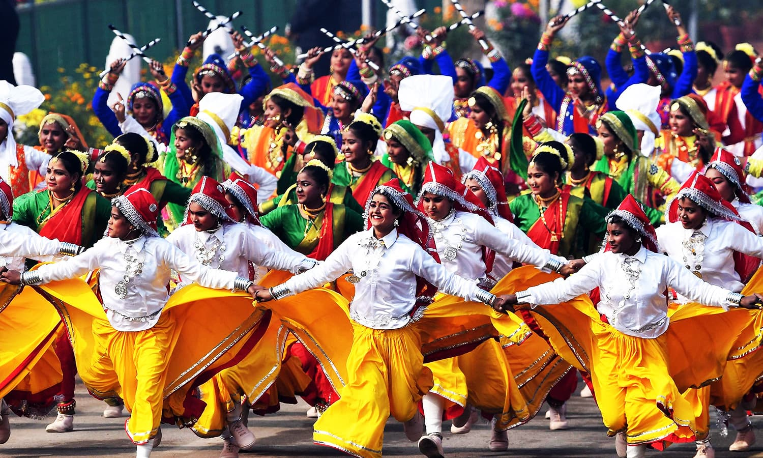 Indian school children perform during India's 69th Republic Day Parade in New Delhi.—AFP