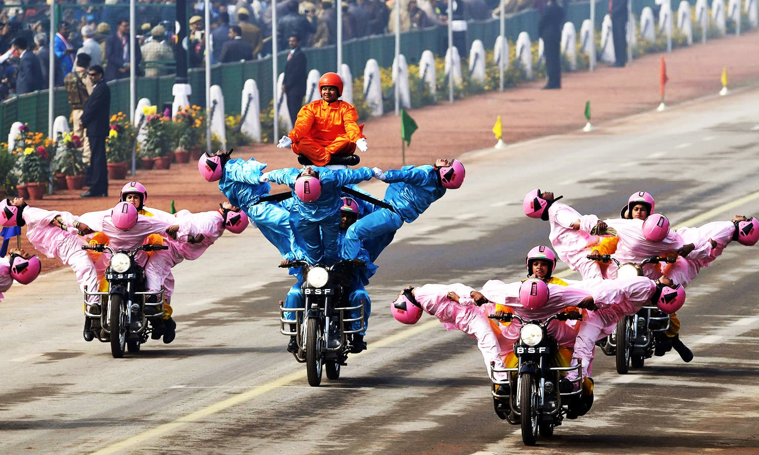 The Indian Border Security Force women's motorcycle team 'Seema Bhawani' performs in New Delhi.—AFP