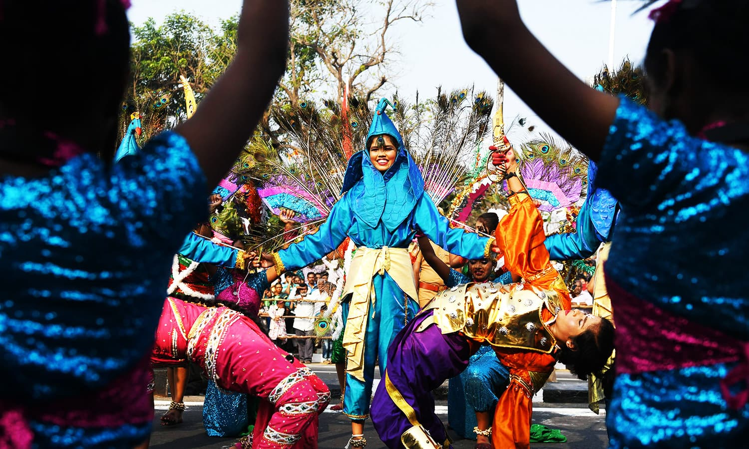 Indian school students perform a peacock dance during Republic Day celebration in Chennai.—AFP