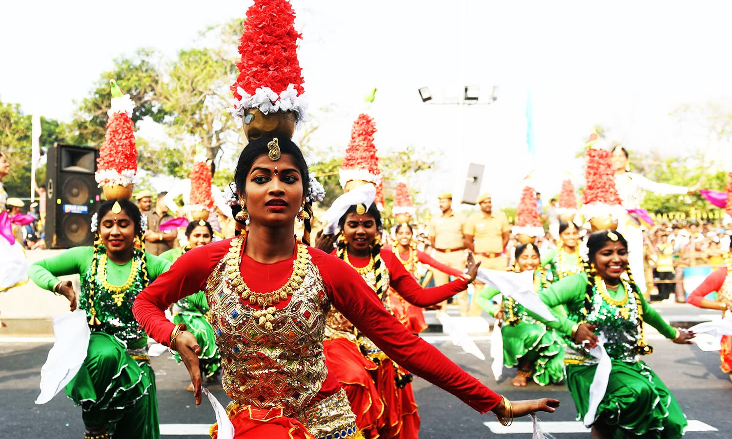 Indian school students perform a 'Karagattam' folk dance during Republic Day celebration in Chennai.—AFP