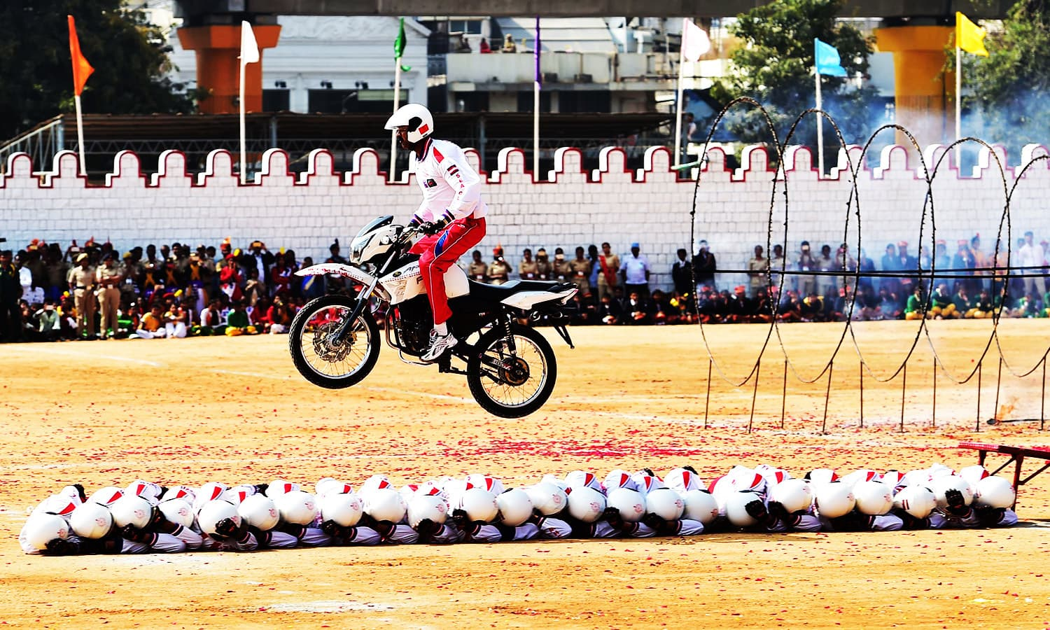 Shwetha Ashwas of the Indian Military Police performs stunts during Republic Day celebrations in Bangalore.—AFP