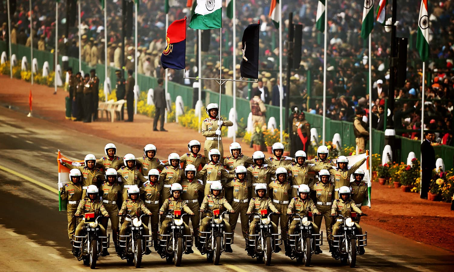 Indian Border Security Force bikers perform during India's 69th Republic Day Parade in New Delhi.—AFP