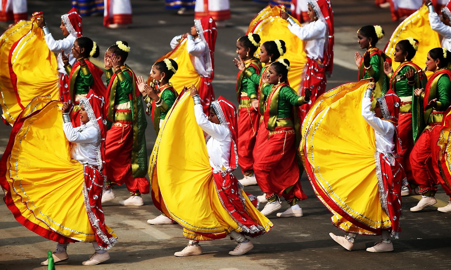 Indian school students perform during India's 69th Republic Day Parade in New Delhi.—AFP