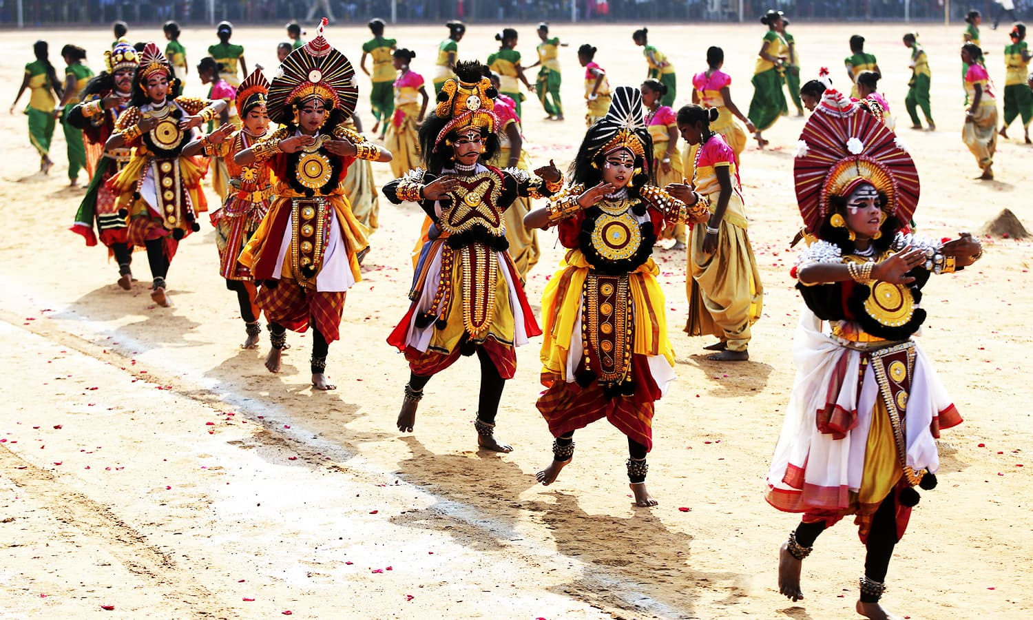 Indian school children dressed in traditional costumes perform during Republic Day celebrations in Bangalore.—AP