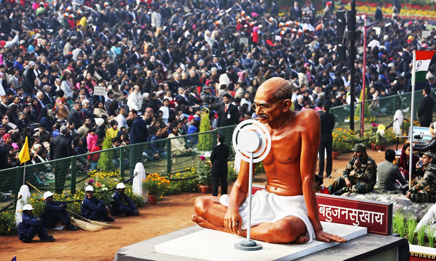 A tableaux featuring Mahatma Gandhi moves through Rajpath, the ceremonial boulevard, during Republic Day parade in New Delhi.—AP