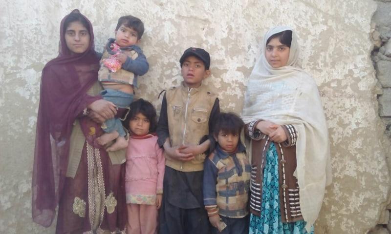 CHILDREN of slain polio worker Sakeena Bibi are standing at their house.—Photo by writer