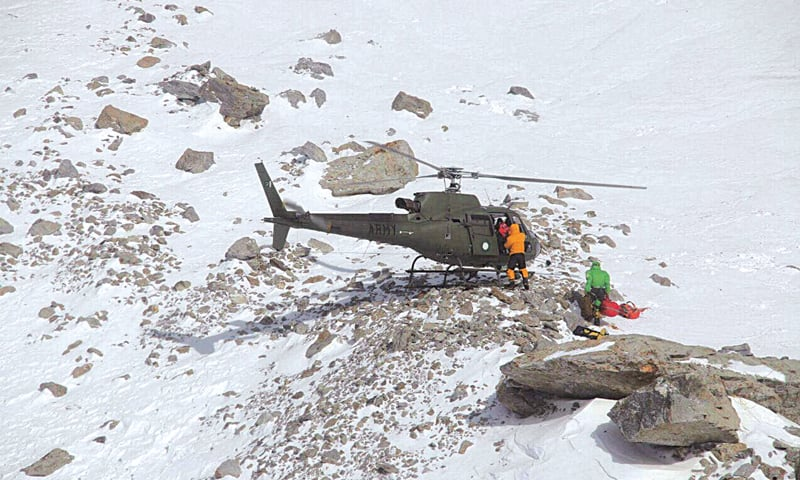 MEMBERS of a Polish K2 expedition rescue French climber Elisabeth Revol on Sunday.—AFP