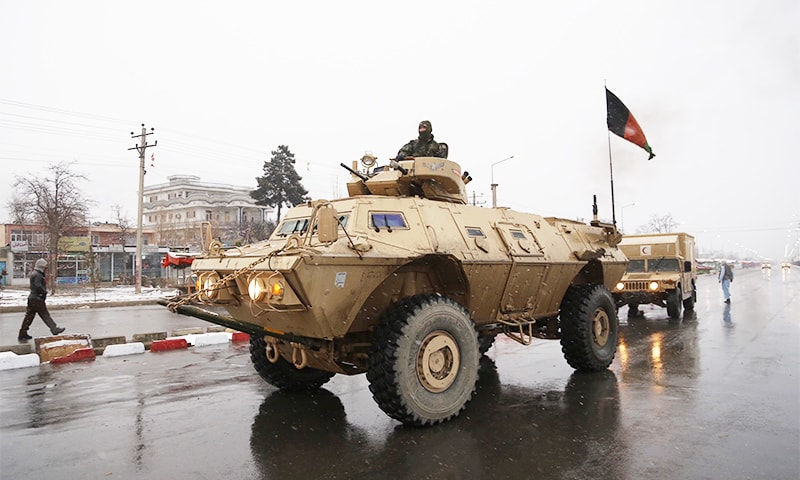 Afghan security personnel arrive at the site of an attack at the Marshal Fahim academy in Kabul.─AP