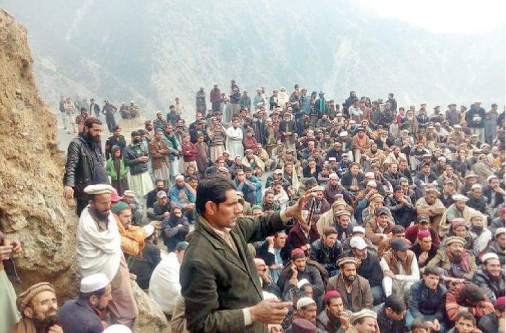 Protesters block Karakoram Highway in Pattan on Monday. — Dawn