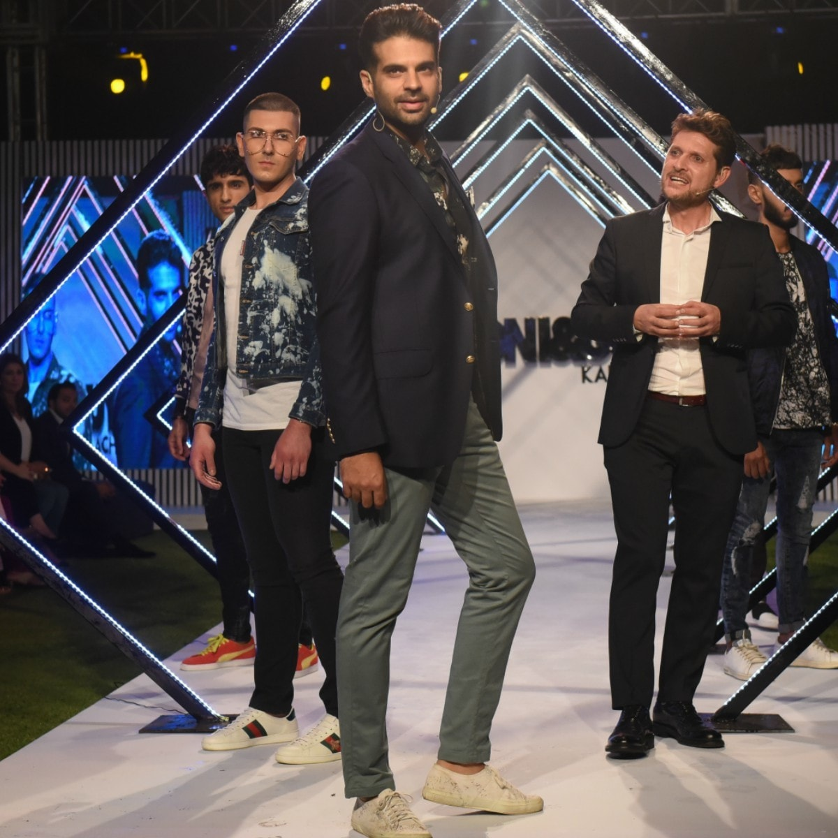 Host of the evening Adnan Malik takes his turn on the catwalk