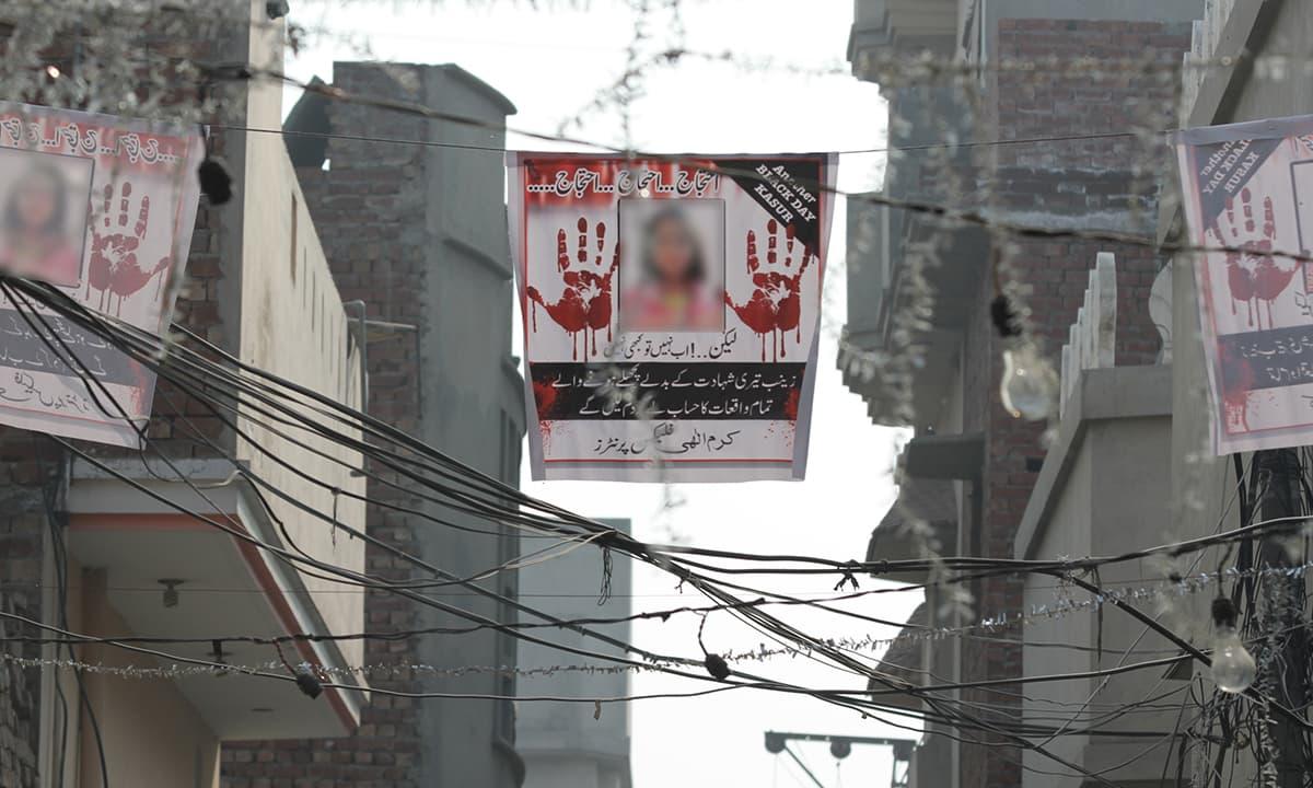 Posters protesting Zainab's murder hang above a street in Kasur | Feryal Ali Gauhar