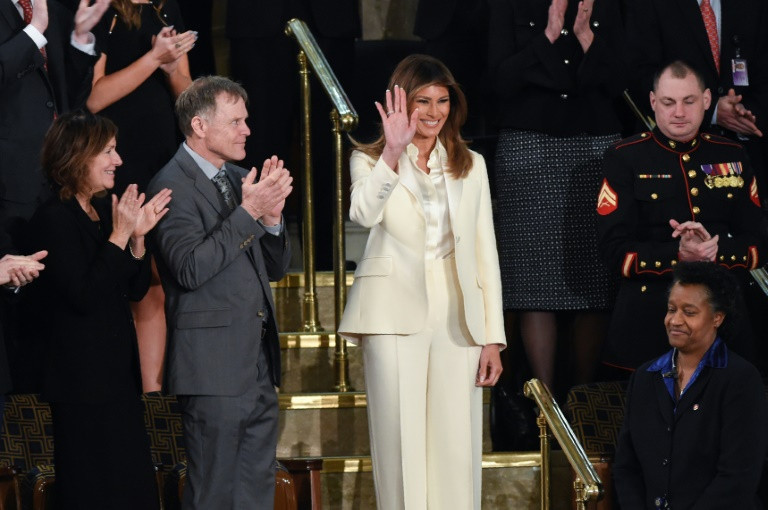 US First Lady Melania Trump arrived in Congress to warm applause ahead of President Donald Trump's State of the Union address.─AFP