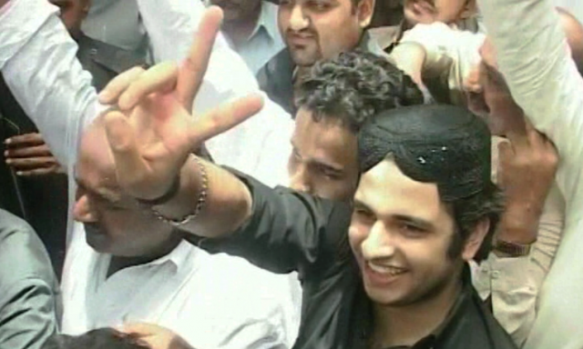 Jatoi during one of his initial appearances in court flashed a victory sign.─File