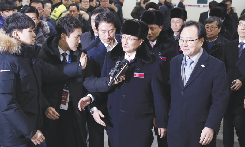 GANGNEUNG: The North Korean delegation which includes 10 athletes, arrives at the Yangyang International Airport on Thursday.—AFP