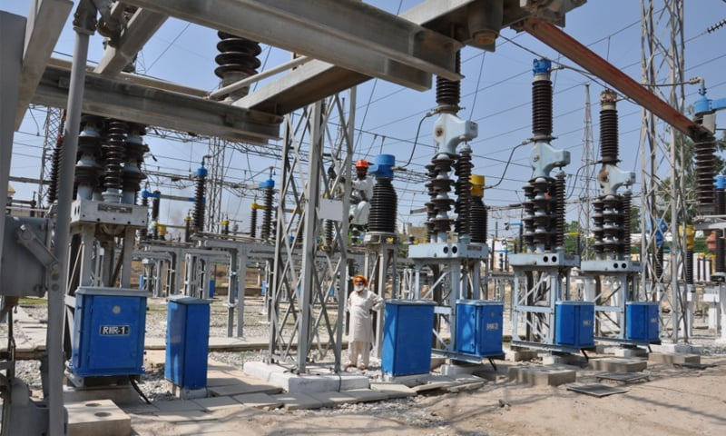 An employee works on Rohri grid station in this file photo. The CEOs of four Discos have been removed due to their failure in meeting targets to check electricity theft, reduce line losses and improve revenue collection.