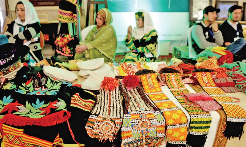 Women from the Kalash Valley display handmade accessories at an exhibition held to mark the 35th anniversary of the Aga Khan Rural Support Programme. — White Star