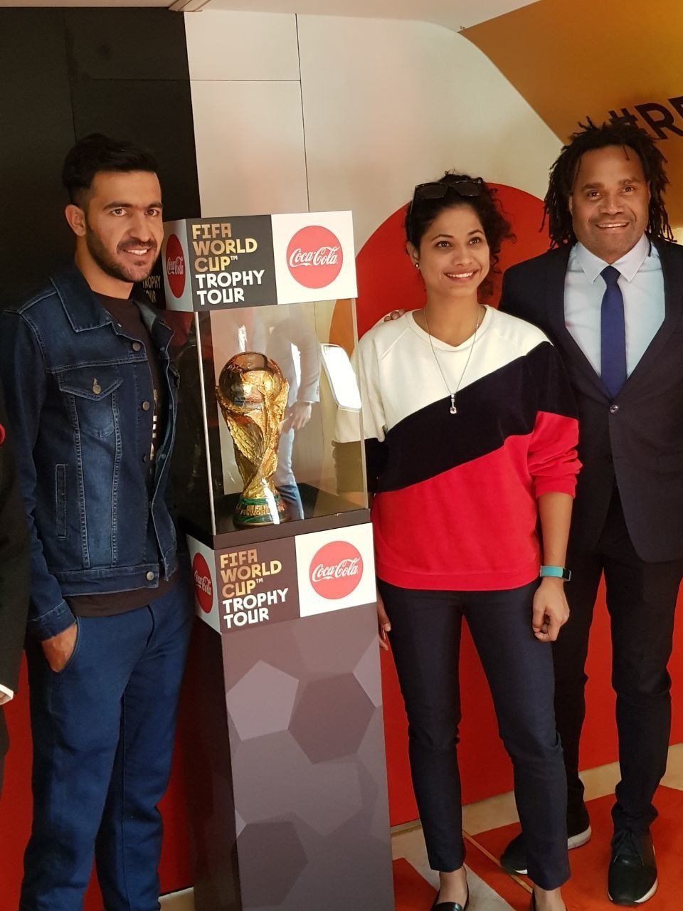 Karembeu, Kaleemullah and Hajra pose with the trophy