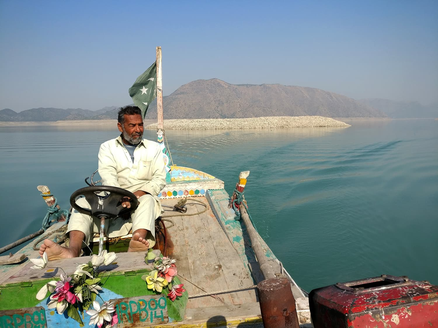 The site of the former fort of Bharukot stands out in the middle of the Tarbela Lake as a small island.