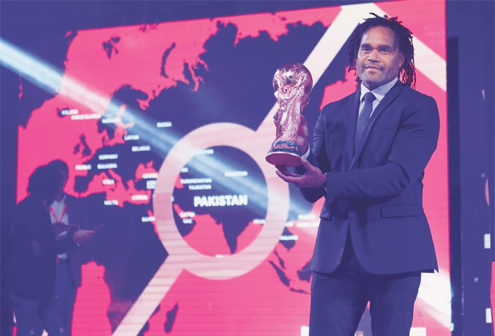 LAHORE: Former France international Christian Karembeu holds the FIFA World Cup trophy during the ceremony held here on Saturday.—M. Arif/White Star