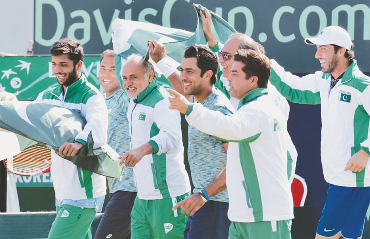ISLAMABAD: Members of Pakistan's Davis Cup squad celebrate their victory against South Korea at the Pakistan Sports Complex on Saturday.—Tanveer Shahzad/White Star