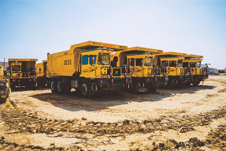 Dumper trucks at the Thar-Block-II mining site