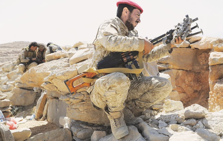 IN this Feb 2 photo, a soldier allied to Yemen's internationally recognised government adjusts his machine-gun in an area on the outskirts of Sanaa.—AP