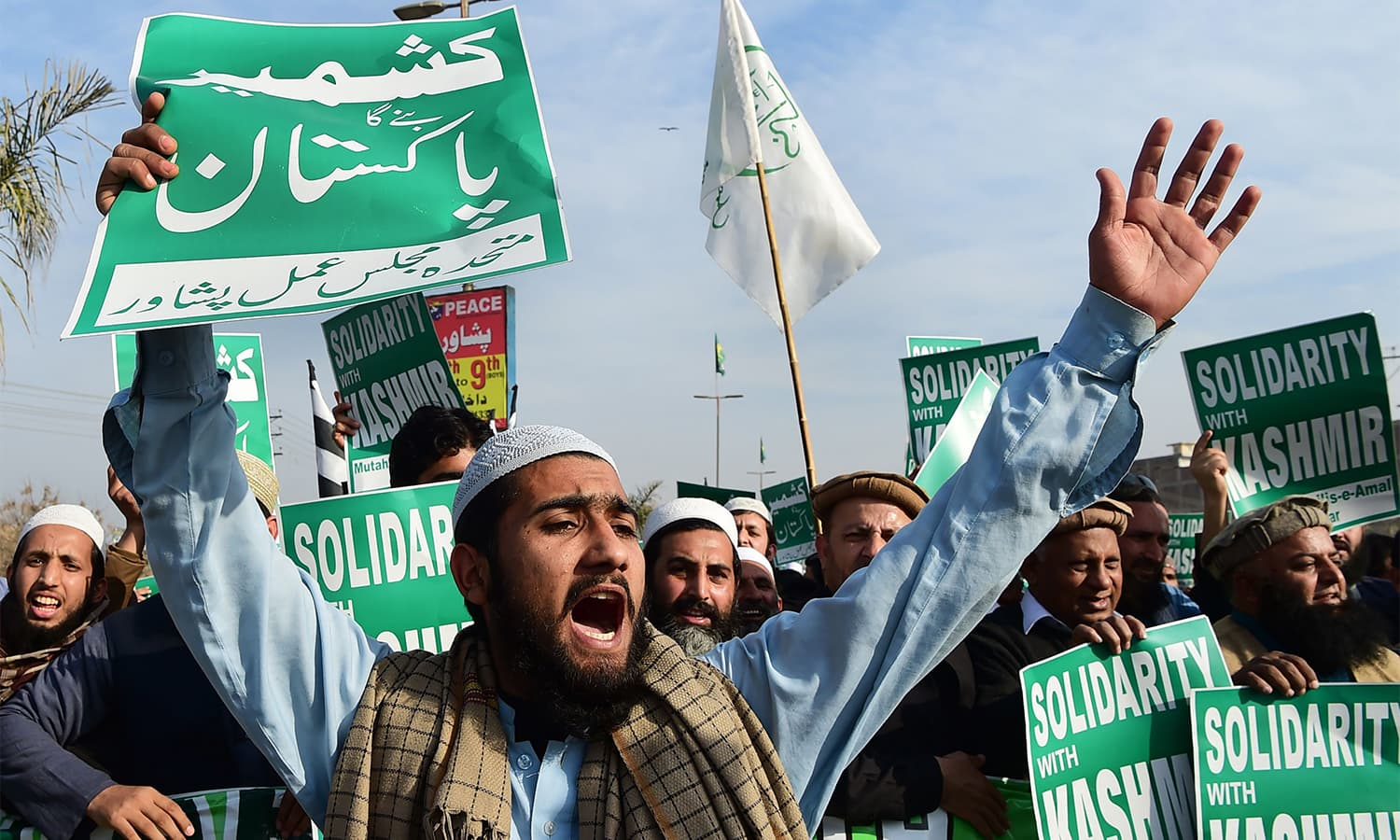 Protester shout slogans as they take part in a gathering to mark Kashmir Day in Peshawar. — AFP