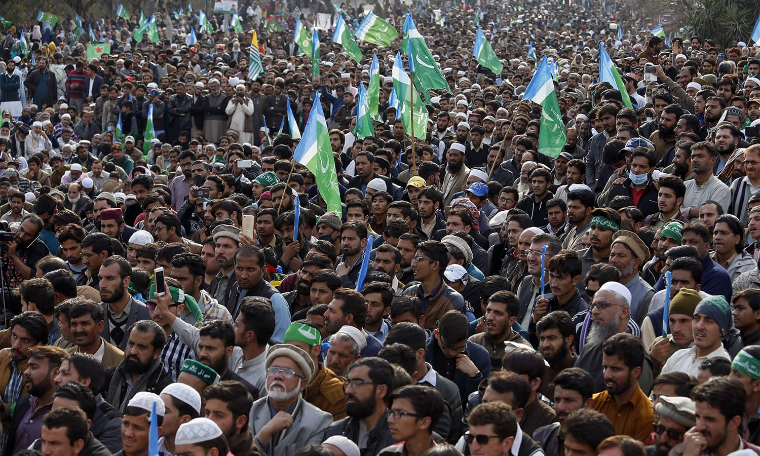 Jamaat-i-Islami supporters participate in a rally in Islamabad. — AFP