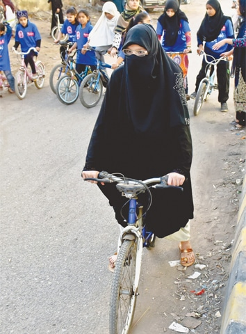 GIRLS from the Lyari Girls' Cafe learning to ride on rented bicycles in front of the Naval flats. —Fahim Siddiqi / White Star