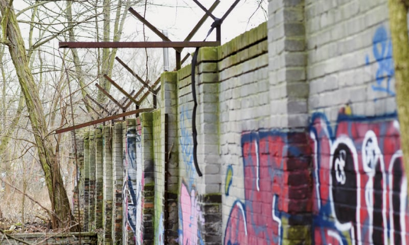This Jan 24 file photo shows an 80-metre piece of the wall in a forest in Berlin.—AP
