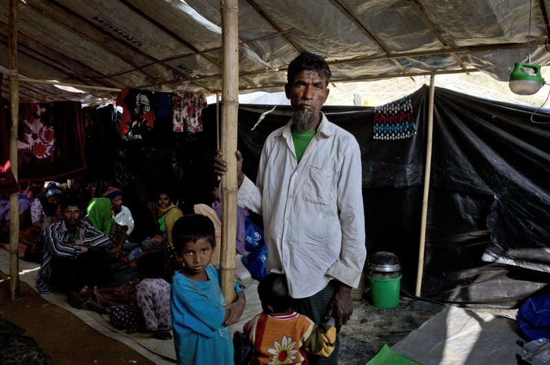 In this Jan 15 photo, newly arrived Rohingya refugee Mohammad Ilyas, 55, stands in a makeshift transit shelter at the Nayapara camp near Cox's Bazar, Bangladesh. ─ AP