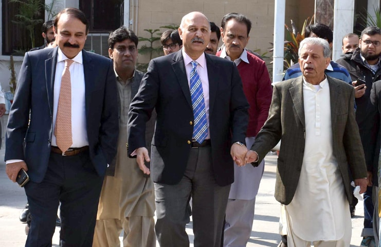 ISLAMABAD: PML-N candidate for a Senate seat Mushahid Hussain Sayed along with other party leaders comes out of the ECP building after submitting his nomination papers on Thursday.—Online