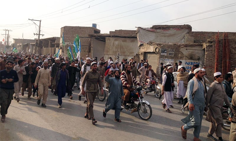 Protesters march against the conviction of 31 men involved in Mashal Khan's murder in Mardan.— Photo by author