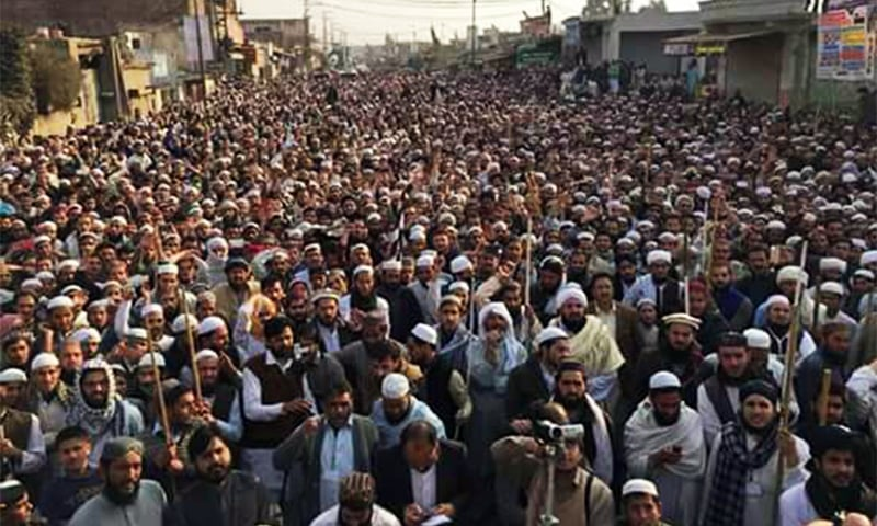 A view of the protest in Mardan on Friday.— DawnNews