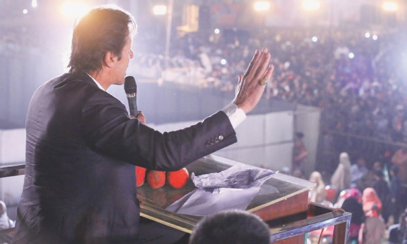 LODHRAN: Pakistan Tehreek-i-Insaf chairman Imran Khan addressing a rally held here on Friday as part of campaigning for by-election in the NA-154 constituency.—Online