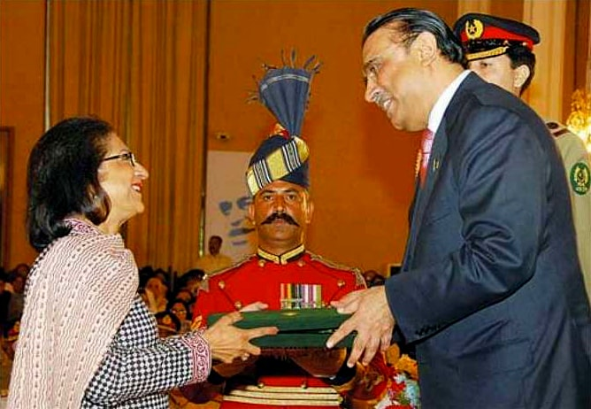 A beaming Asma Jahangir is awarded the Hilal-i-Imtiaz by then president Asif Ali Zardari at a Pakistan Day investiture ceremony in 2010. ─ Dawn/File