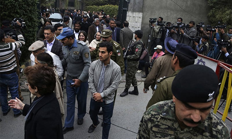 People gather at Asma Jahangir's residence, following her death, in Lahore. ─ AP
