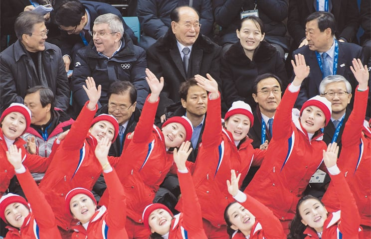 NORTH Korean cheerleaders perform before (top left to right) South Korean President Moon Jae-in, International Olympic Committee President Thomas Bach, Presidium of the Supreme Peoples Assembly of North Korea President Kim Yong-nam, Kim Yo-jong, the younger sister of North Korea's leader Kim Jong-un, and Pyeongchang Organising Committee President Lee Hee-Beom during the women's ice hockey match between the unified Korea and Switzerland at the Pyeongchang 2018 Winter Olympics on Feb 10.—AFP