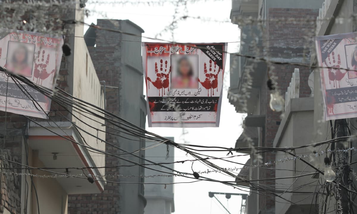 Posters protesting Zainab's murder hang above a street in Kasur | Feryal Ali Gauhar