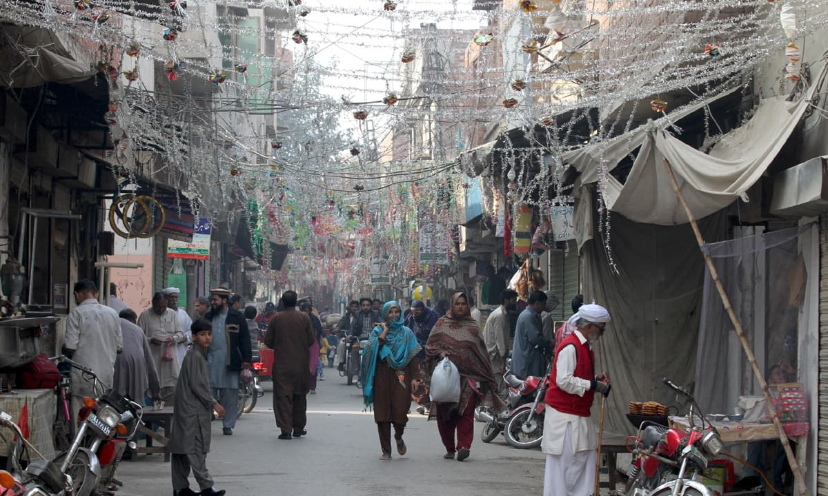 A street in Road Kot bazaar, decorated with bunting and tinsel to mark the twelfth of Rabiul Awal | Feryal Ali Gauhar