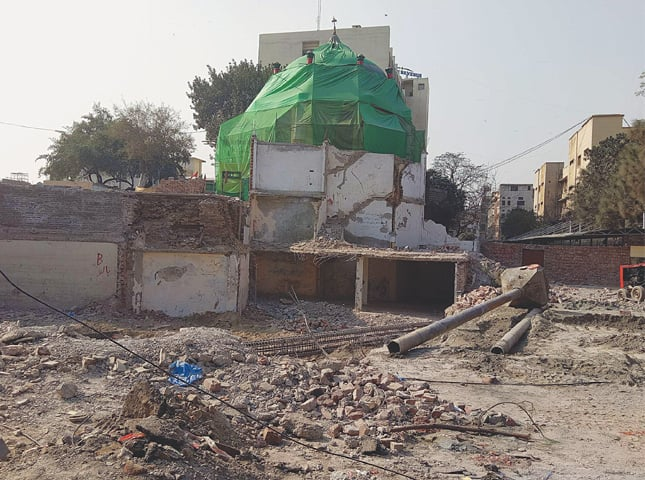 HAZRAT Mauj Darya Bukhari's shrine where demolition is under way in connection with the Orange Line Metro Train project.—Photo by writer