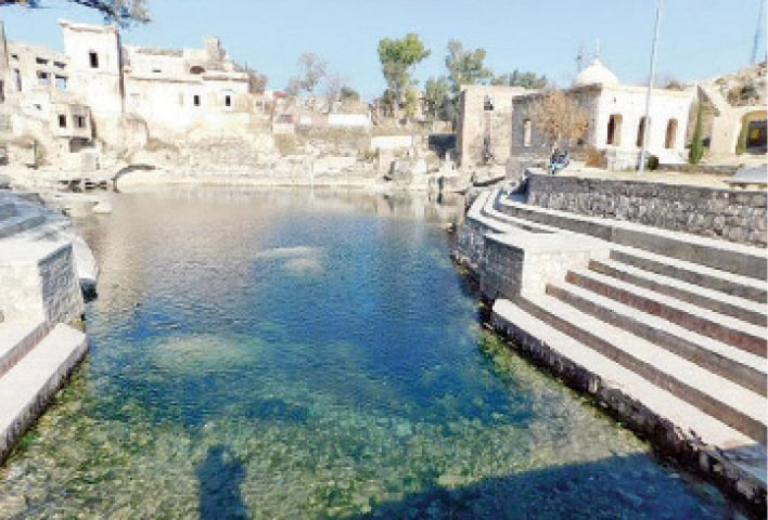 The Katas Raj pond, which had dried out a few months ago, has been refilled by a cement factory. — Dawn