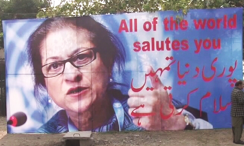 "A panaflex erected by a roadside displaying Asma Jahangir reads ""All of the world salutes you"". ─ DawnNews"