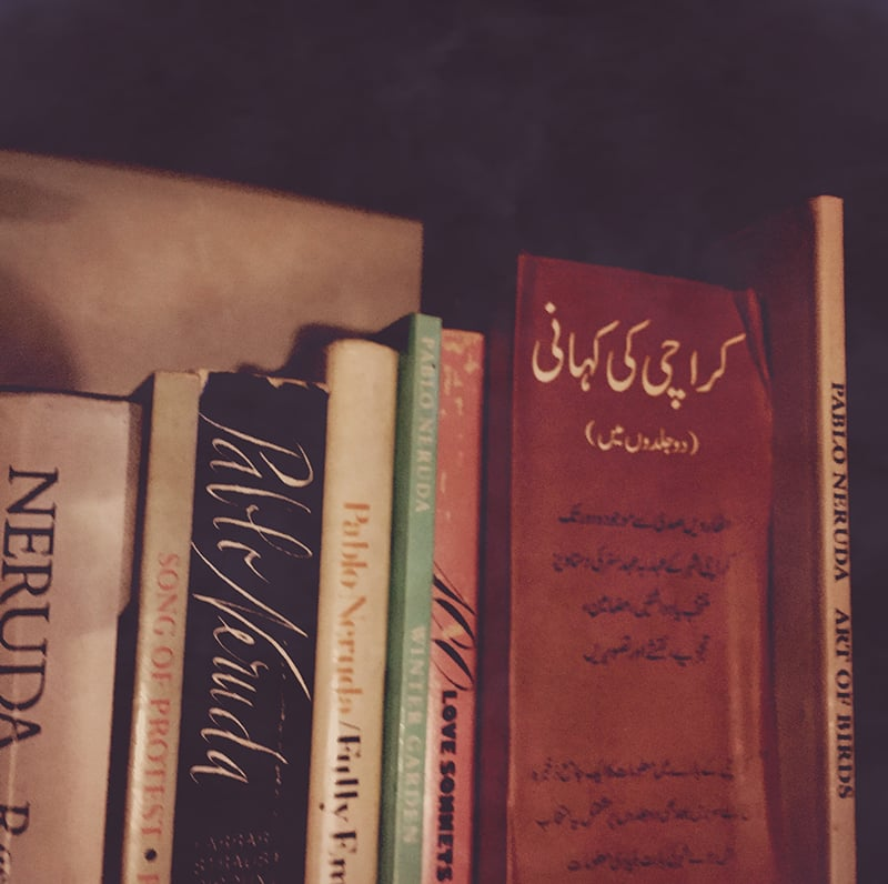 The author's books inside her library, reminiscent of her days in Karachi, also burned down in the fire.