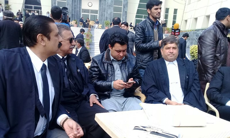 Mashal's brother, Aimal Khan, with his team of lawyers at the Peshawar High Court, on Tuesday. ─ Photo by author