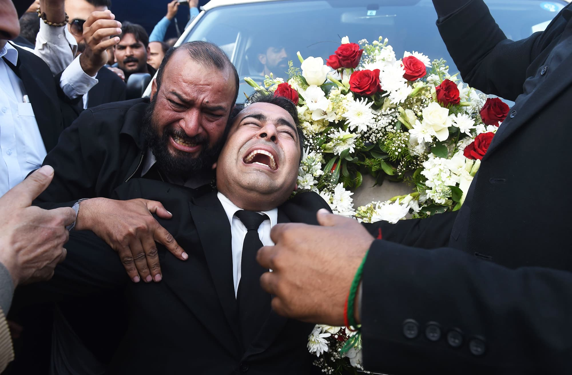 Pakistani colleagues of lawyer and rights advocate Asma Jahangir mourn alongside the vehicle carrying her coffin during her funeral in Lahore on February 13, 2018.