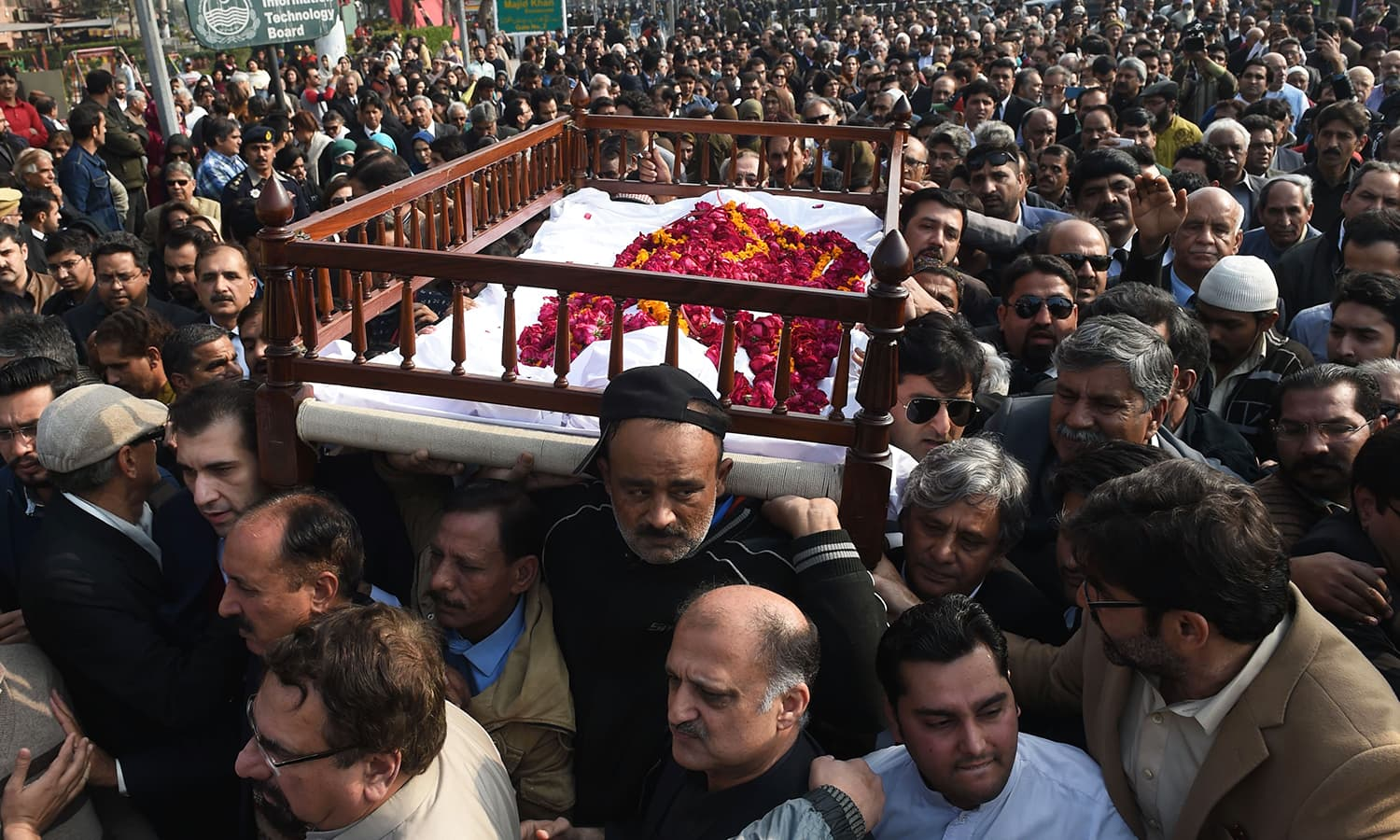 Mourners carry the coffin of lawyer and rights advocate Asma Jahangir during her funeral. — AFP