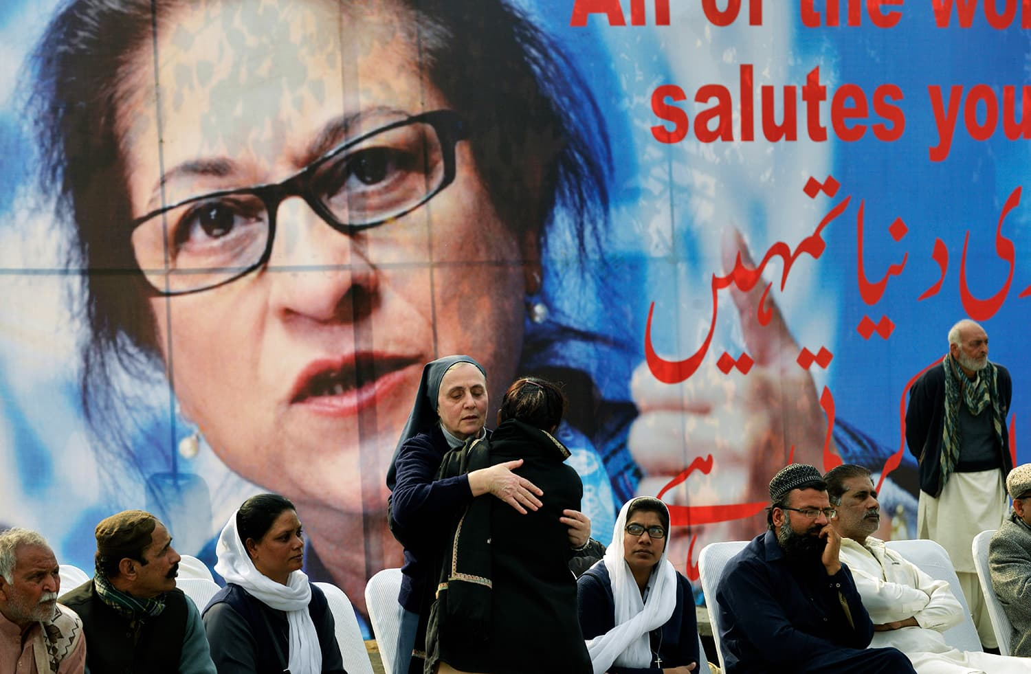 Colleagues of lawyer and rights advocate Asma Jahangir mourn during her funeral in Lahore on Tuesday. — AFP