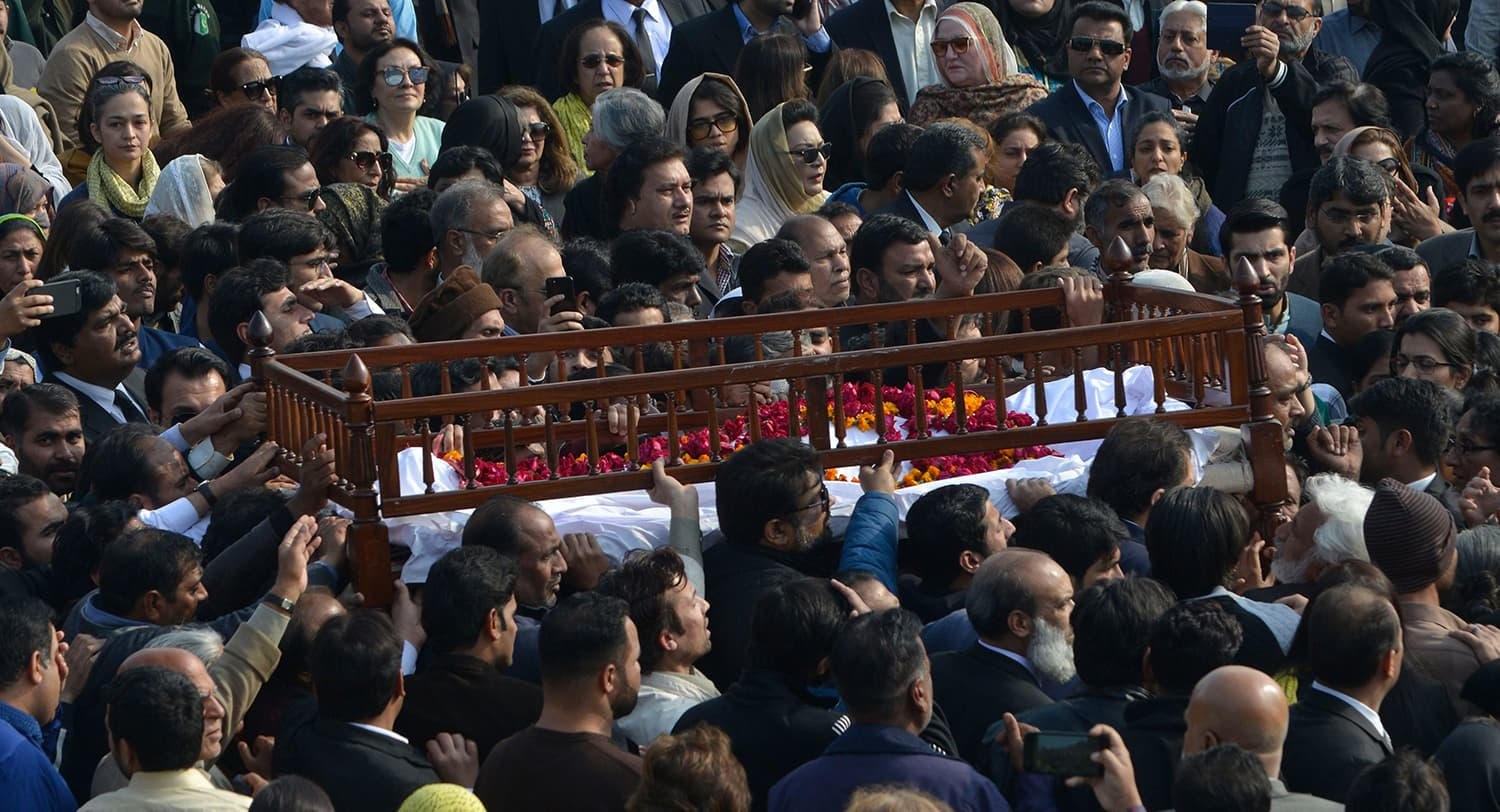 Mourners carry the coffin of lawyer and rights advocate Asma Jahangir during her funeral in Lahore. — AFP