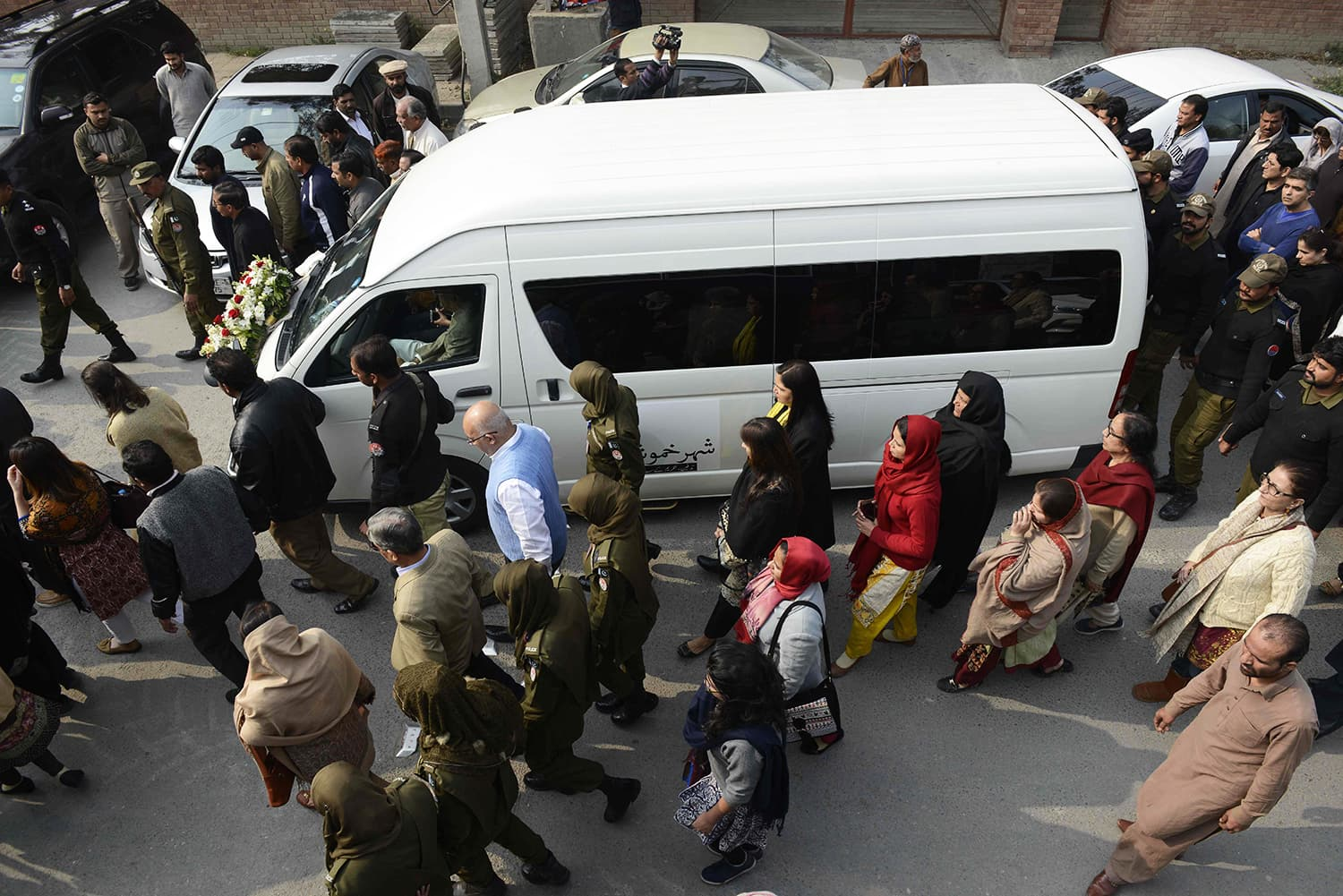 Mourners march alongside a vehicle carrying the coffin of lawyer and rights advocate Asma Jahangir during her funeral  AFP